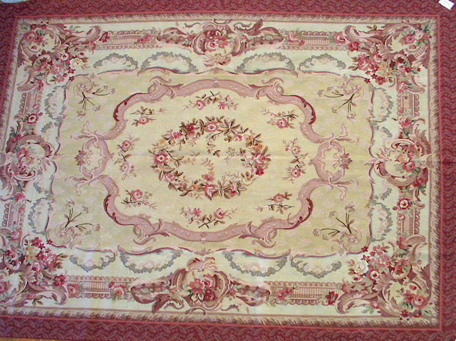 A Chinese carpet size approximately 9ft. x 12ft.