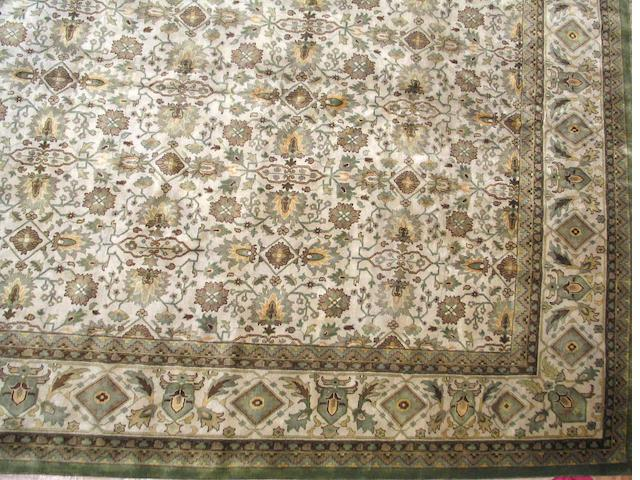 An Oushak design carpet size approximately 11ft. 11in. x 17ft. 10in.