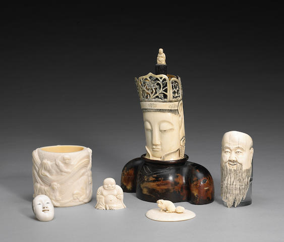 A group of five Asian ivory carvings