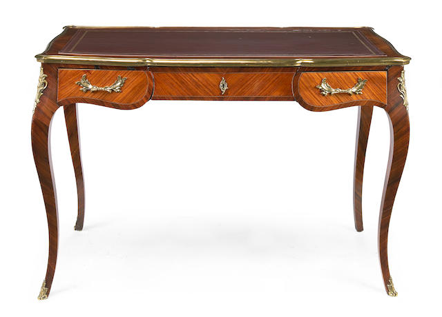 A Louis XV style kingwood and rosewood bureau plat