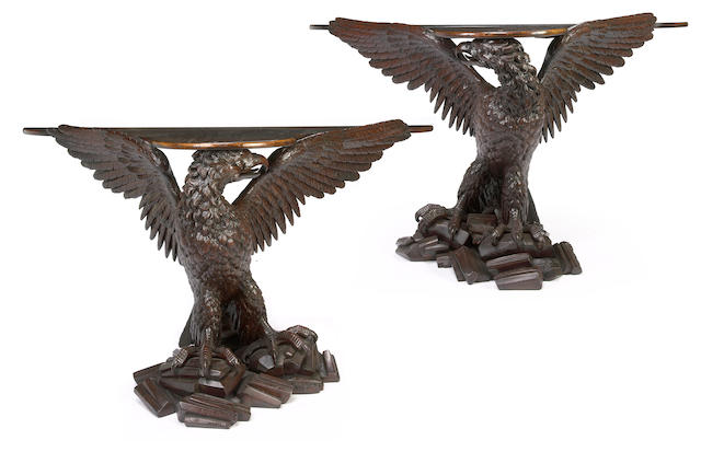 An imposing pair of George II style carved mahogany console tables  late 19th/early 20th century