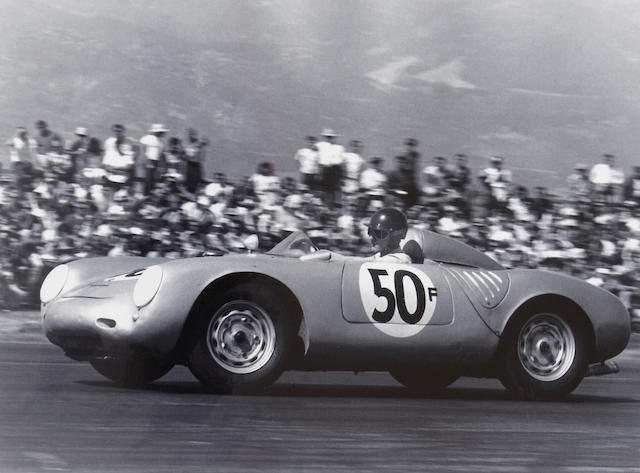 A monochrome photograph of Ken Miles in the Porsche 550 Spyder,