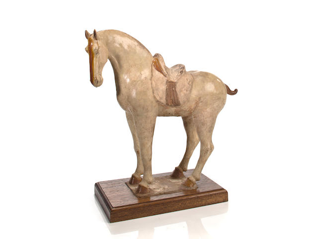 A Chinese cream-glazed pottery horse Tang Dynasty (618-907)