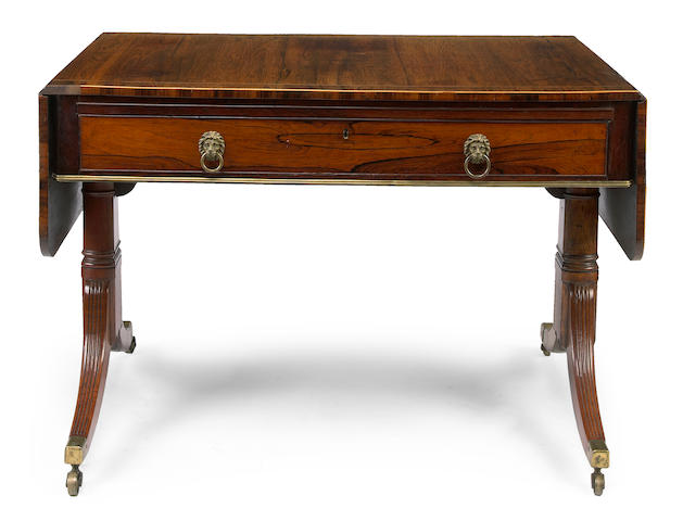 A good Regency brass mounted rosewood sofa table