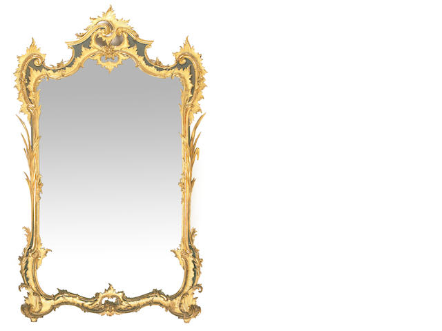 A Louis XV style carved giltwood and parcel ebonized mirror