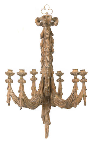 An Italian Neoclassical carved pine chandelier