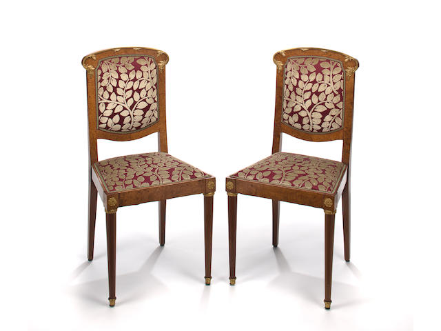 A set of eight Art Nouveau gilt-bronze-mounted walnut dining chairs circa 1900