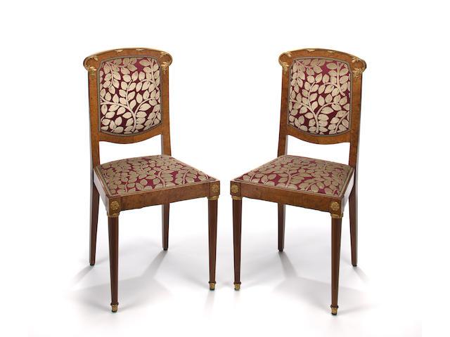 A set of eight Art Nouveau gilt-bronze-mounted walnut dining chairs circa 1900