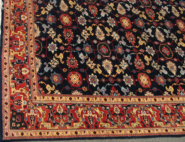 A Turkish carpet size approximately 12ft. 6in. x 16ft.