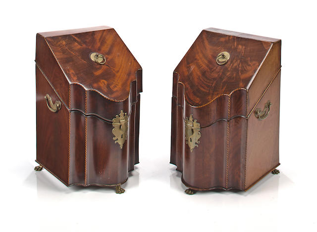 A pair of George III mahogany knife boxes