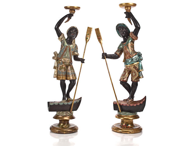 A pair of Italian Baroque style blackamoor candlesticks