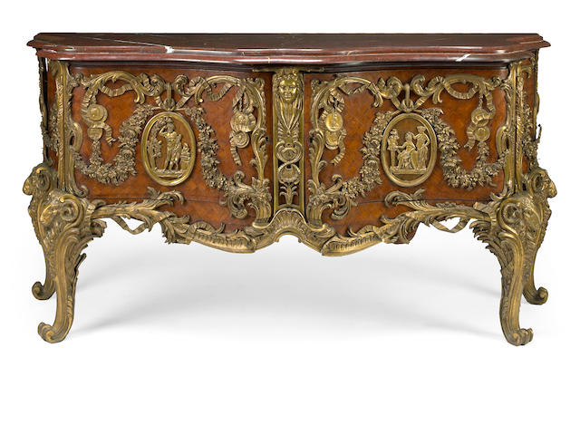 A Louis XV style gilt bronze mounted kingwood commode, after Gaudreaux