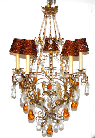 A Rococo style clear and colored glass gilt metal five light chandelier