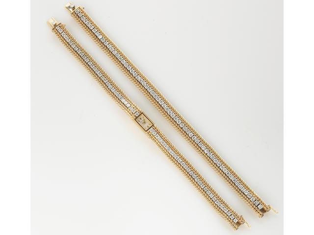A diamond and eighteen karat bicolor gold backwind wristwatch with matching bracelet