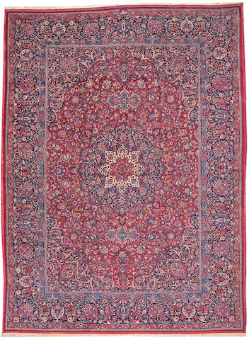 A Meshed Amoghli carpet size approximately 9ft. 10in. x 13ft. 3in.