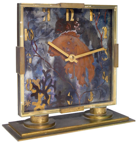 A French Art Deco gilt bronze and églomisé  mantel clock retailed by I Magnin & Co