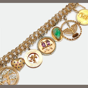 A cultured pearl, gem-set and fourteen karat gold charm bracelet
