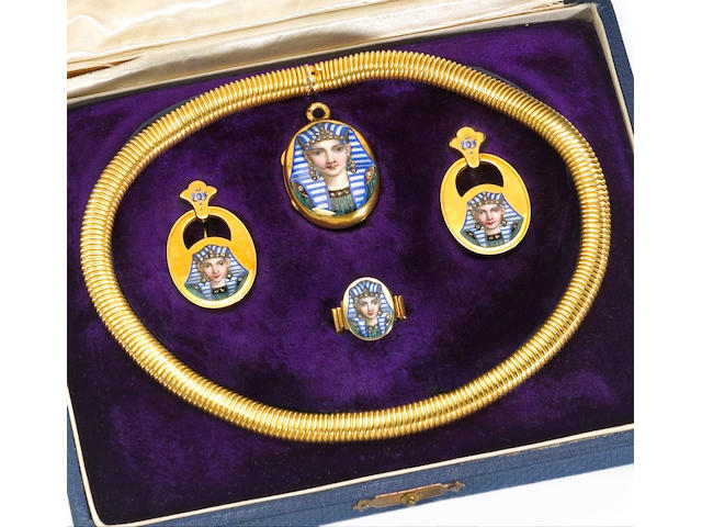 A suite of eighteen karat gold, enamel and diamond jewelry, French