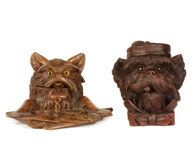 A group of two Continental carved walnut tobacco jars in the form of dogs