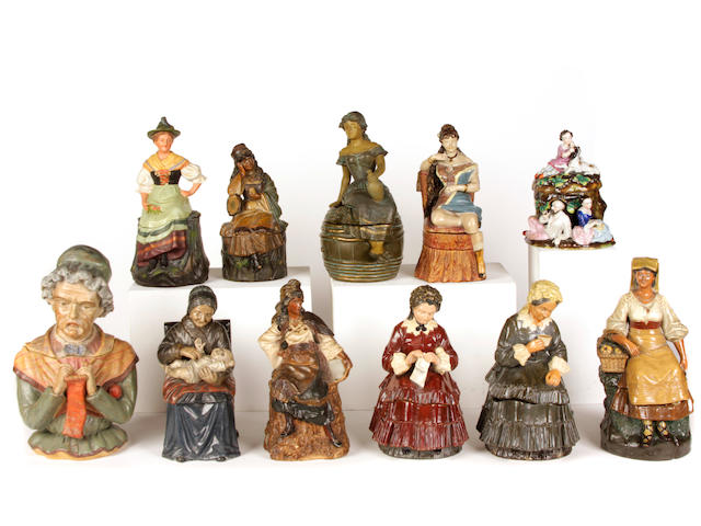 A group of ten Continental earthenware tobacco jars modeled as ladies
