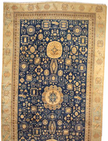 A Khotan carpet Turkestan, size approximately 10ft. 2in. x 19ft. 3in.
