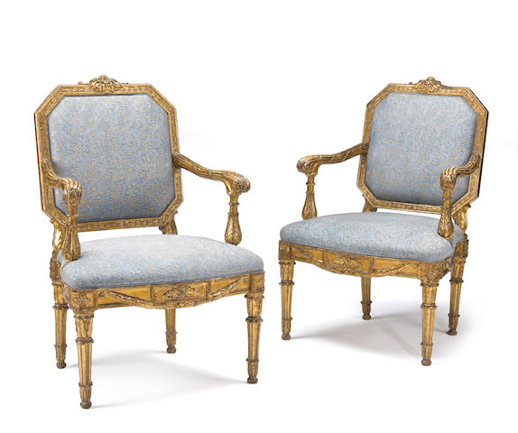 Four Italian Neoclassical giltwood armchairs with blue Fortuny upholstery<br>late 18th century