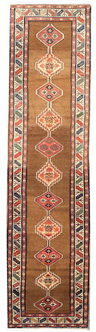 A Serab runner Northwest Persia, size approximately 3ft. 5in. x 13ft. 8in.