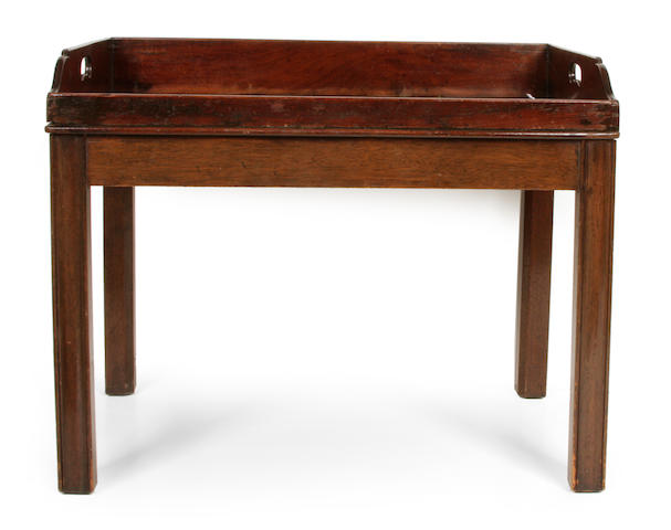 A George III mahogany butler's tray on later stand