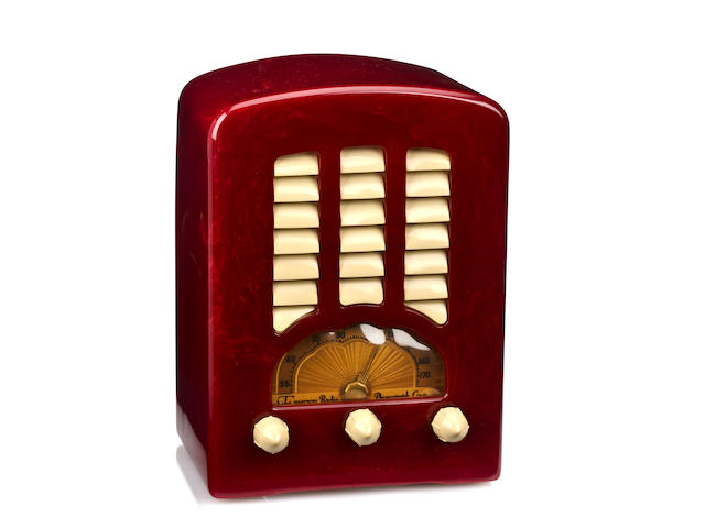 An Emerson Cathedral marbleized red and ivory radio<br>model BT-245, 1938