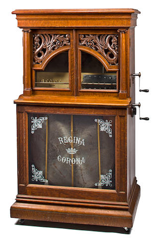 "27"" Regina Dragon Door style 33 oak automatic disc changer. Home model with piano soundboard. Has REGINA CORONA etched glass panel in lower cabinet.  12 discs.  Serial #47953.  Made in USA. Circa 1900.   38"" x 25"" x 67"" high."