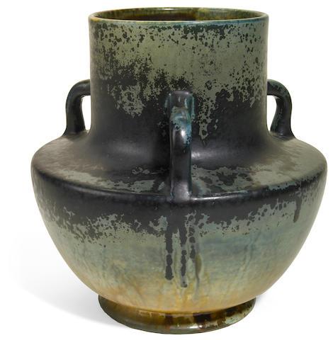 A Tiffany Studios Favrile pottery three handled vase circa 1900