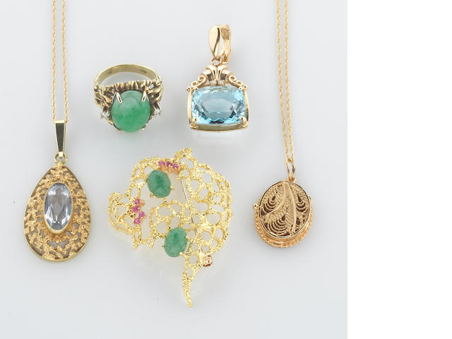 A collection of jade, ruby, amazonite, aquamarine, blue topaz, diamond and 14k gold jewelry, including three pendants, two chains, a ring and a brooch