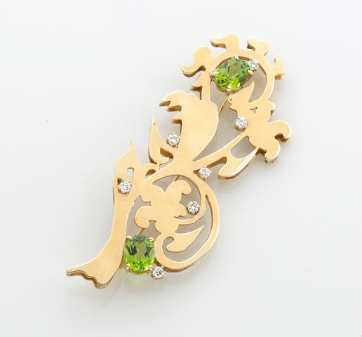 A diamond, peridot and 14k gold brooch