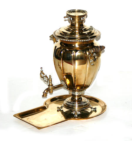 A Russian brass samovar with large tray, small round plate and associated tea pot and waste bowl V.S. Batashev factory, Tula circa 1900