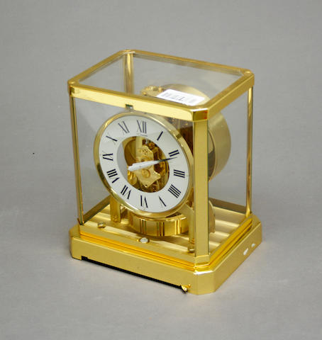 A Jaeger Le Coultre lacquered brass Atmos clock serial number 311141 caliber 528-8 third quarter 20th century