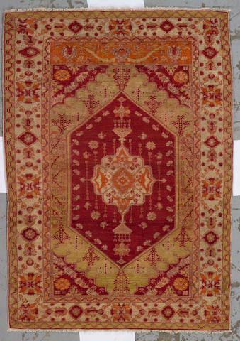 An Oushak rug West Anatolia, size approximately 3ft. 9in. x 5ft. 3in.