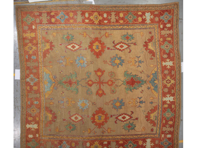 An Oushak carpet West Anatolia, size approximately 14ft. 8in. x 14ft. 6in.