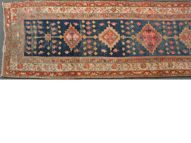 A Kurdish runner size approximately 3ft. 6in. x 13ft. 3in.