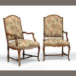 A pair of Italian Rococo walnut upholstered armchairs