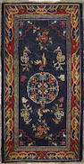 A Tibetan rug   Tibet, size approximately 2ft. 5in. x 4ft. 6in.