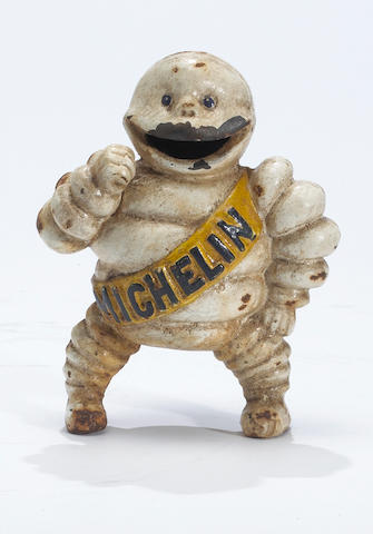 A rare Michelin 'Bibendum' cast iron bank,