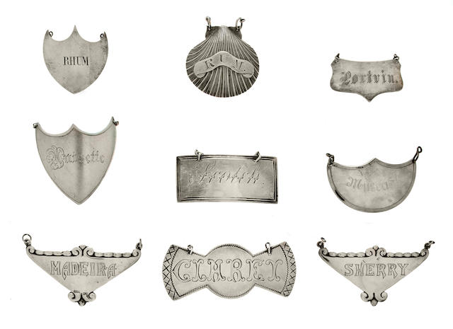 Nine Georgian and Continental silver engraved various bottle tickets<BR />