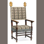 An Italian Baroque parcel gilt walnut armchair, early 18th century