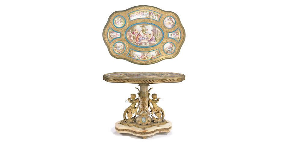 An impressive Napoleon III gilt bronze, porcelain and onyx center table, one panel signed A. Maglin