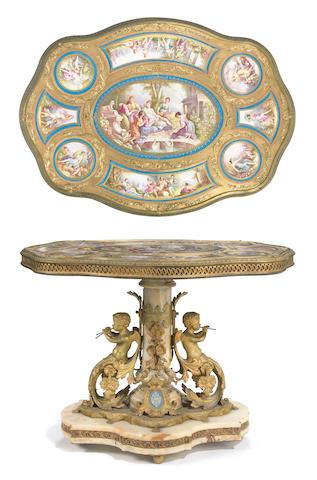 An impressive Napoleon III porcelain and gilt bronze mounted onyx table de milieu  third quarter 19th century