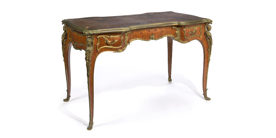 A good Louis XV style gilt bronze mounted marquetry kingwood desk