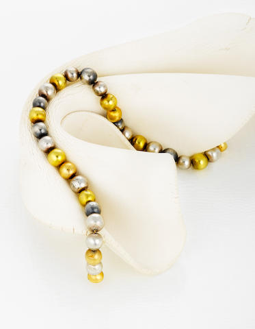 An eighteen karat gold and silver bead necklace, Andrew Grima