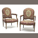 A pair of Louis XVI fruit wood and beech wood fauteuils a la  reine<br>fourth quarter 18th century