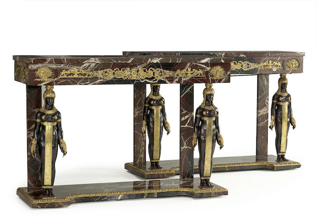A pair of Empire style gilt mounted rouge marble console tables<br>late 19th century