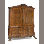 A Dutch Rococo inlaid figured walnut linen press<br>mid 18th century